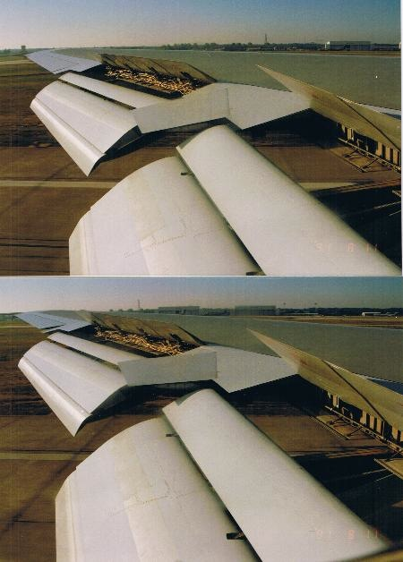 The airbrakes on the 747 wing coming up after touchdown