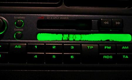 Car radio display showing safe