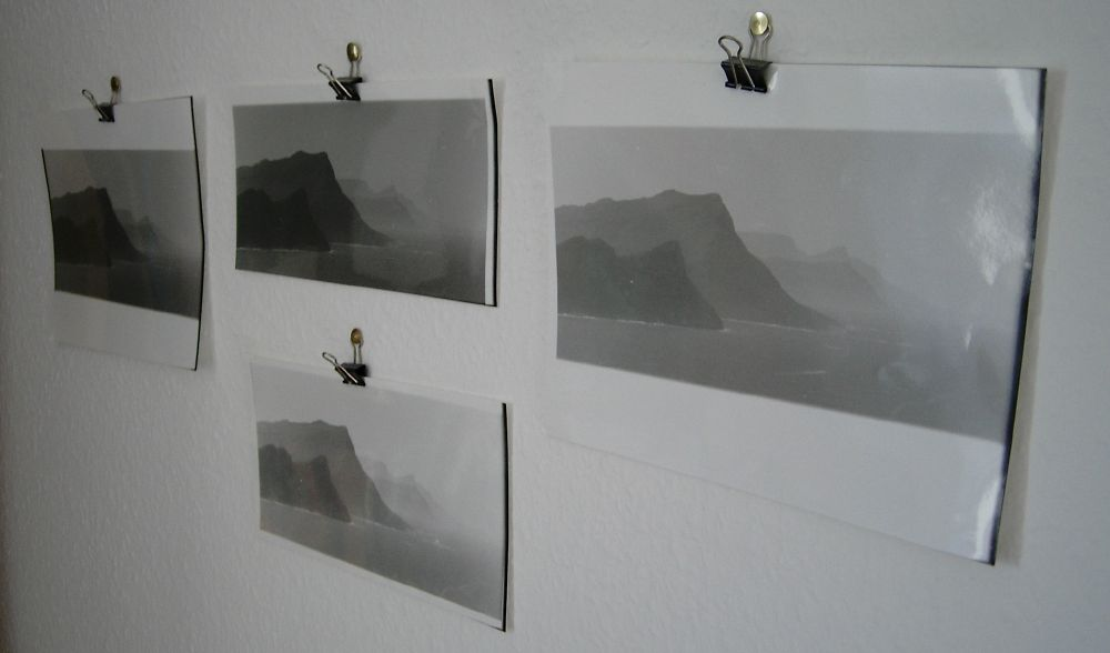 Four prints of the same black and white analogue photo