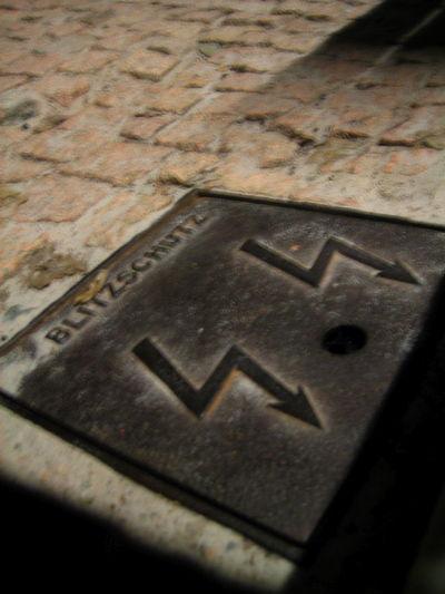 Metal lid labelled 'Blitzschutz'