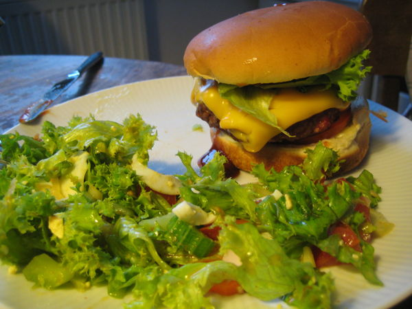 Burger with salad on the side