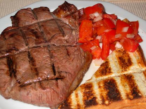 Steak, bread and tomato salad