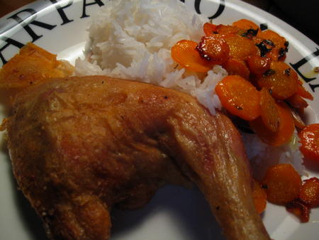 Chicken with rice and carrots, served