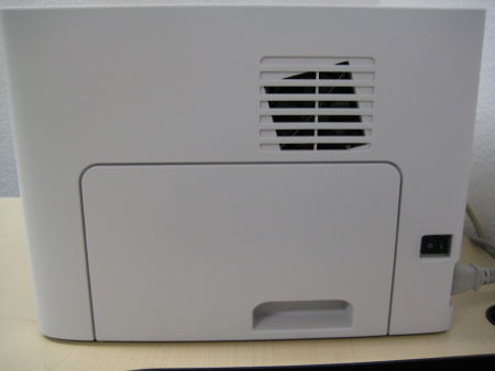 Printer with a hole for ventilation that is at an obviously different angle than the little plastic 'fence' covering it.