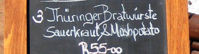 Board advertising Thüringer Bratwürste as a special.