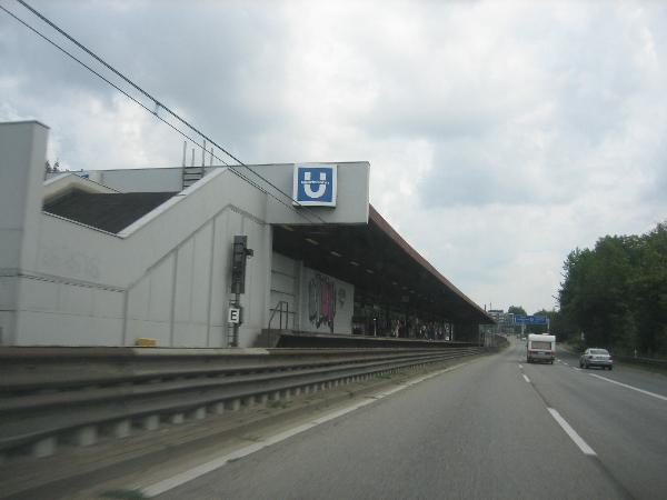 Autobahn with tram stop next to it