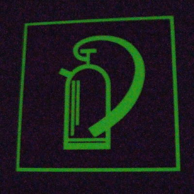 Glowing fire extinguisher sign in the dark