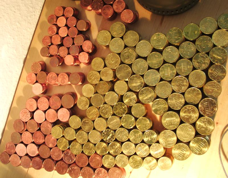 Heaps of Euro cent coins.