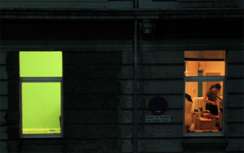 Colourful windows, one green, one warmish