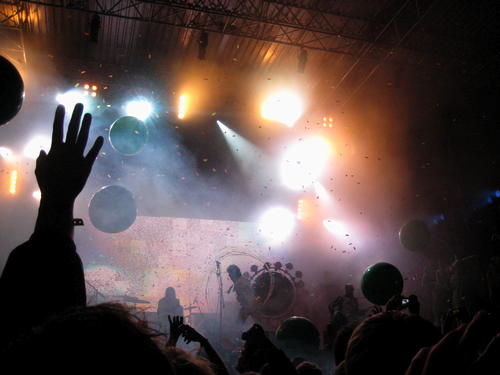 The Flaming Lips on stage with confetti