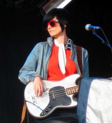 Bassist of Joan as Policewoman on stage