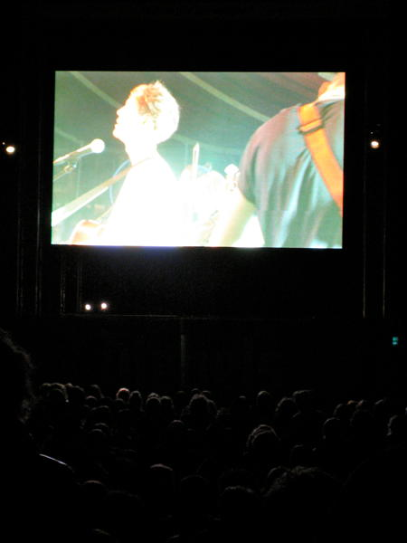 Screen in front of the Spiegelzelt at Haldern 2010. The screen shows Seabear playing inside the tent.