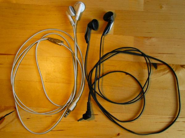 Photo of the broken iPod headphones and the new Sony headphones