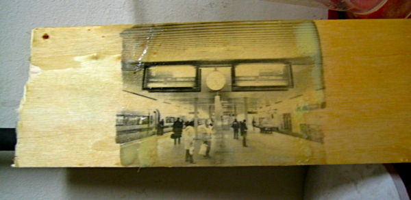 Print of a railway platform on wood