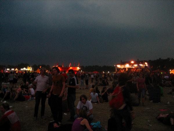 Festival grounds with dark clouds coming up