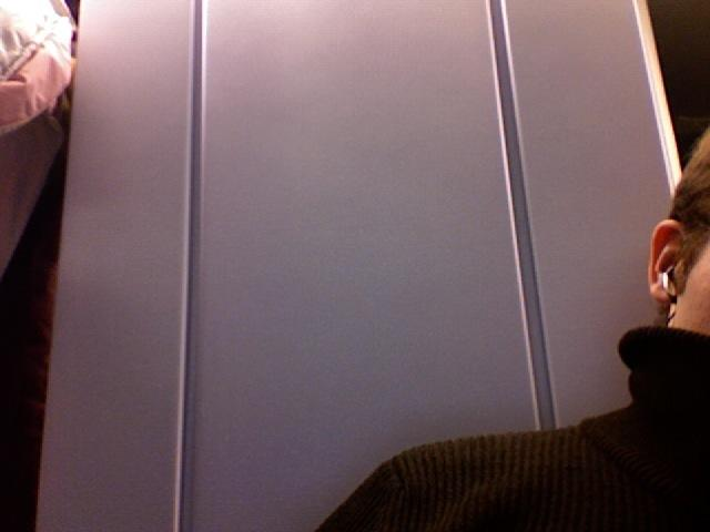 Plastic wall between windows in a train.