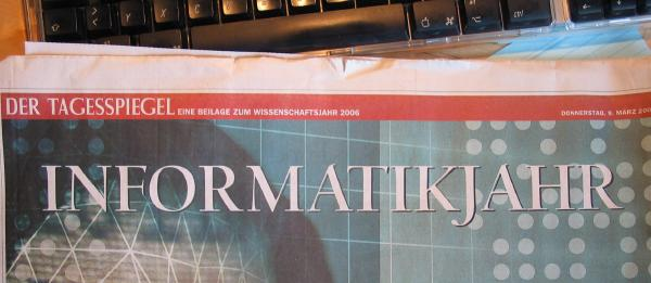 Photo of a newspaper section on the 'Informatikjahr' with an overly large gap between the J and the A