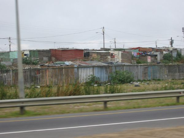 Corrugated Iron huts next to the motorway