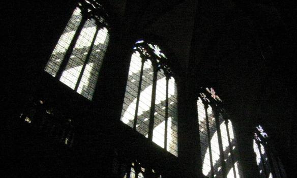 Windows of the cathedral with shadow of the outer structure falling on them