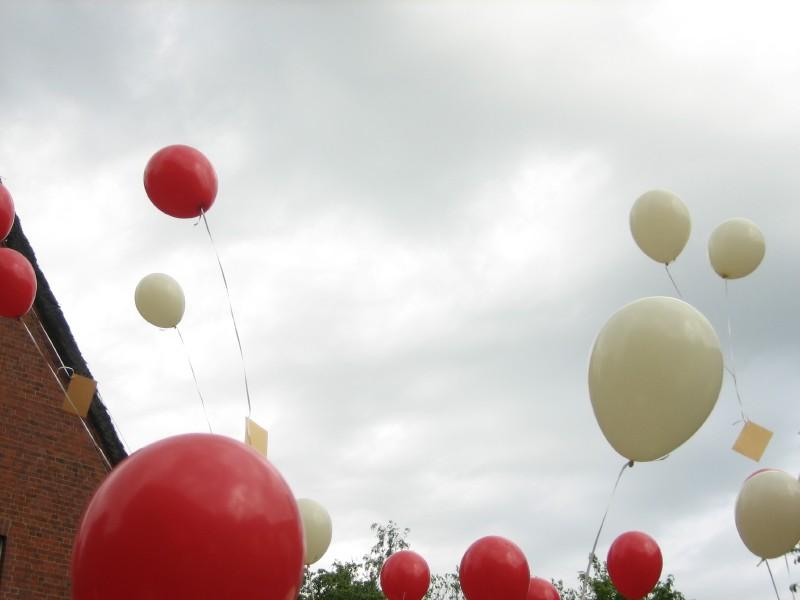 Balloons flying away.