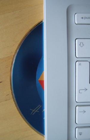 CD which wasn't ejected quite far enough and scratched in the process