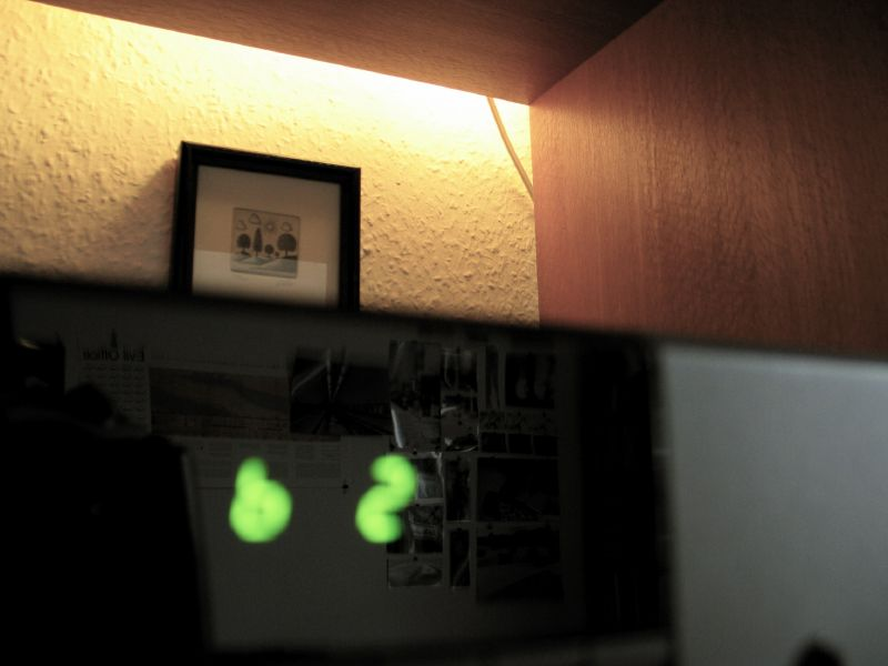 Photo of the stereo with increased bass setting with reflections in the display.