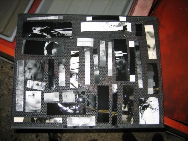 Tray with many little photo snippets used for testing the exposure
