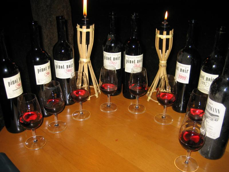 Eight bottles of pinot noir on a table
