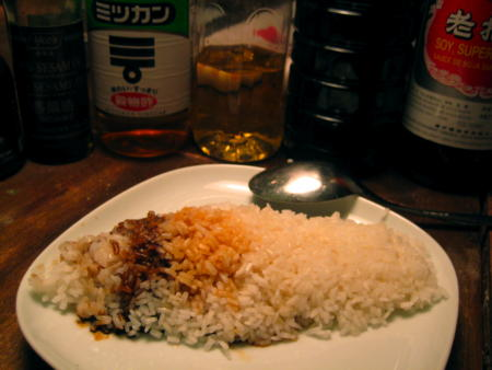 Plate with rice, part of which is brown
