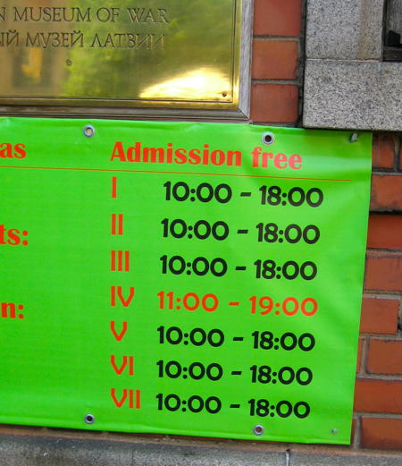 Sign with opening times for the War Museum.