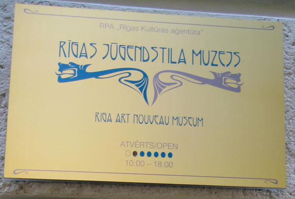 Sign for opening times of the Art Nouveau museum