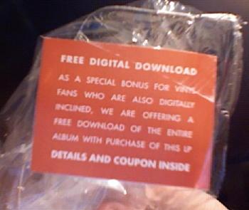 Sticker advertising the free digital downalod