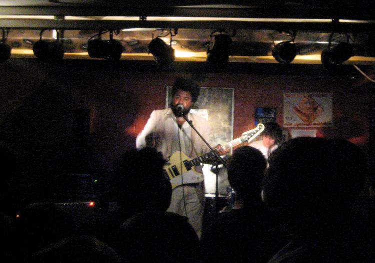 The singer and drummer of The Jai-Alai Savant on stage