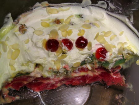 Trifle, half of which has been eaten already