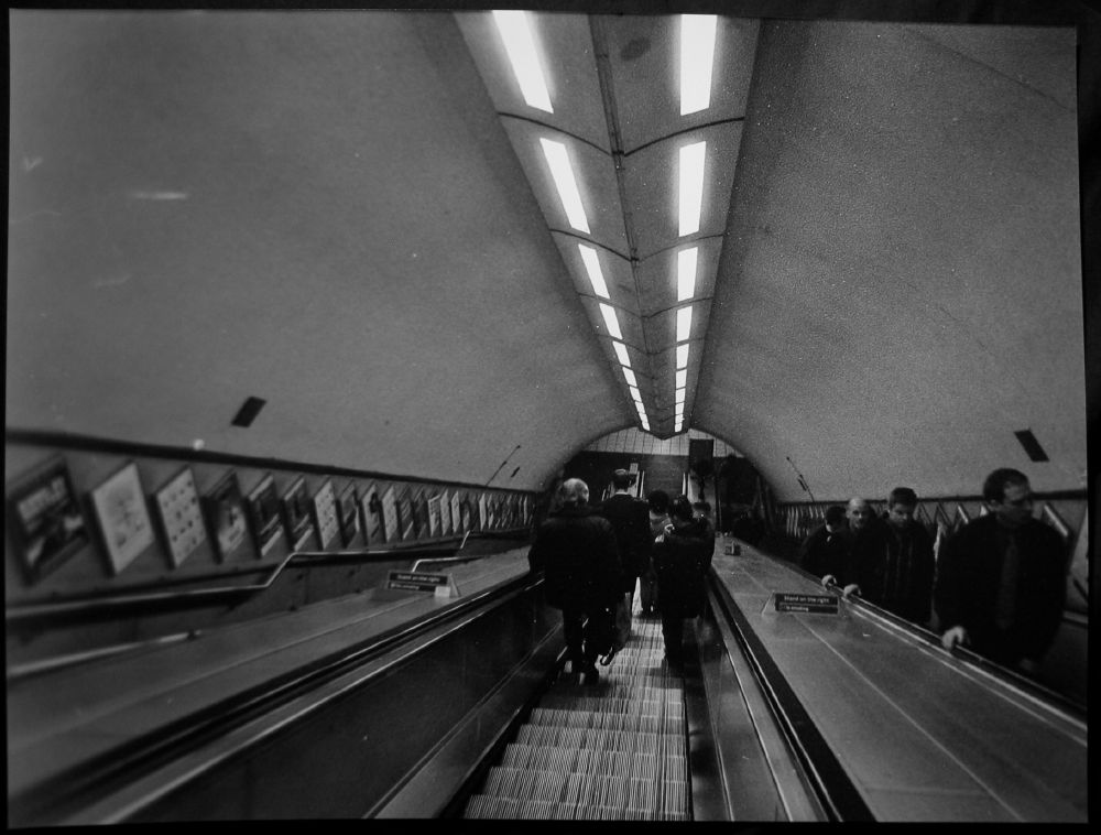 black and white print of a photo taken on an escalator in the London Underground