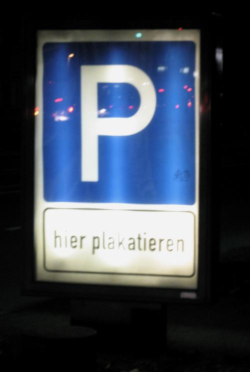 Poster with Parking sign saying 'Hier Plakatieren'
