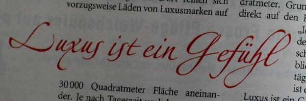Newspaper snippet with text 'Luxus ist ein Gefühl'