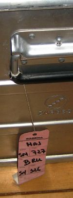 Metal box with luggage tag for Sabena flights from Johannesburg to Hannover, via Brussels