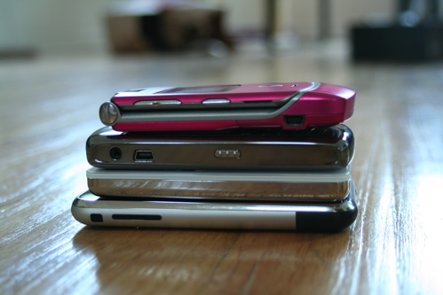 iPhone, iPod, RAZR phone and some other phone on top of each other