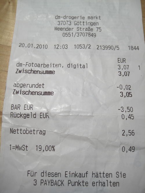 Receipt from d.m. Drogeriemarkt, reducing the total by €0,02 to the next multiple of 5 cents