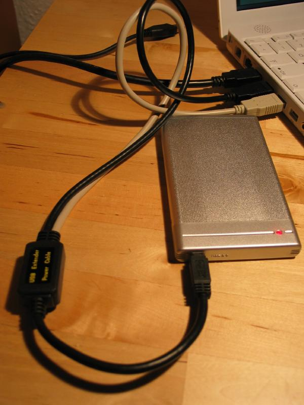 The USB drive connected to two USB ports using the special cable