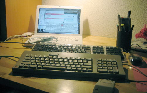 MacBook with three keyboards