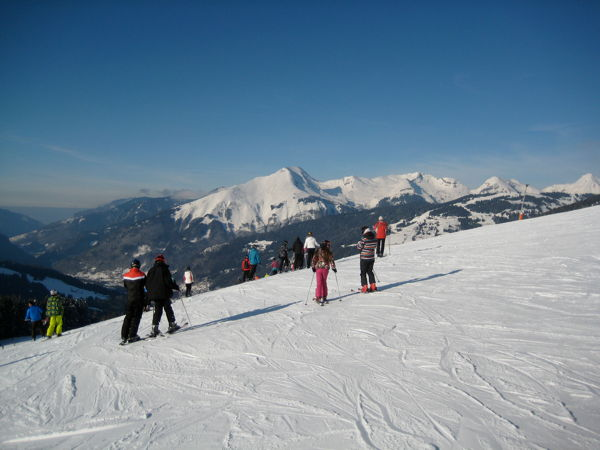 Ski piste with landscape in the background