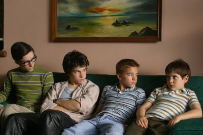 Shot from C.R.A.Z.Y. with four brothers sitting on the couch.