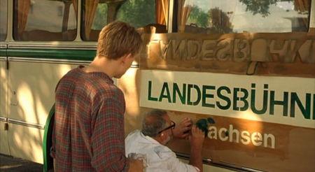 Stencelling 'LANDESBÜHNEN Sachsen' on a bus