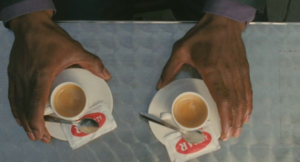 Two coffees on a café table