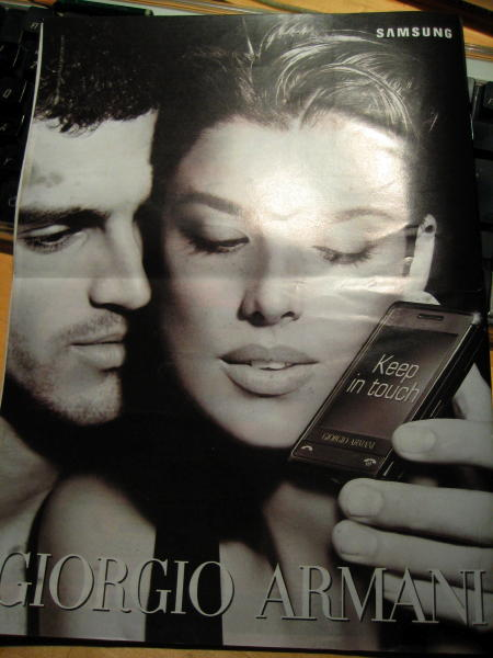 Armani phone ad on the back of a magazine