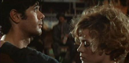 Robert and Gloria dancing unhappily