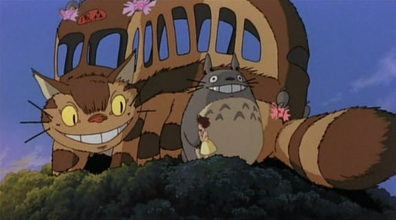 Totoro and the cat bus on a tree