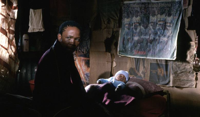 Tsotsi and the baby in his shack.